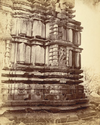 Close view of temple, showing details of moulding at base of tower and sculpture niche of Varaha, Garhwa, Allahabad District